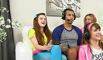 Three teen babes seduce a gamer and suck his huge dick
