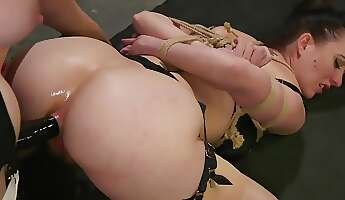 Mistress with red hair uses strapon and fingers to satisfy slave